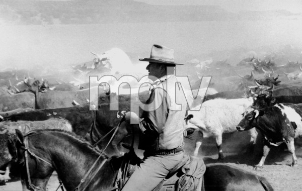 "John Wayne riding a horse for ""The Cowboys,"" 1971. © 1978 David SuttonMPTV - Image 3370_13"