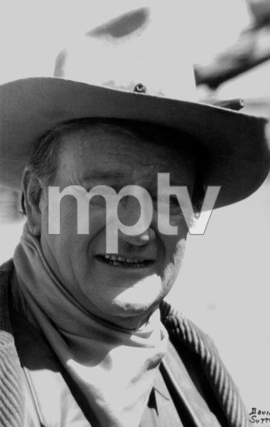 """John Wayne, portrait for """"The Cowboys,"""" 1971. © 1978 David Sutton - Image 3370_586"""