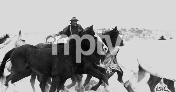 "John Wayne riding a horse for ""The Cowboys,"" 1971. © 1978 David SuttonMPTV - Image 3370_588"