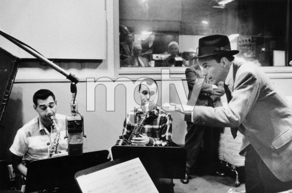 "Frank Sinatra at ""The Man with the Golden Arm"" recording session, Hollywood, CA, 1955.(Otto Preminger and Kim Novak in control room) © 1978 Bob Willoughby / MPTV - Image 337_1687"