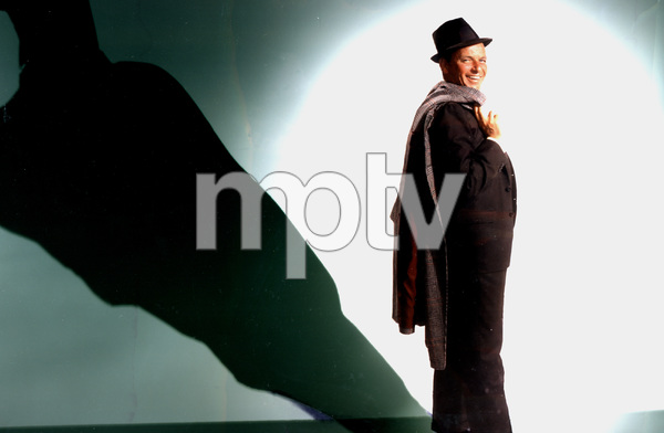 Frank Sinatra standing with a coat over this shoulder, circa 1963. © 1978 Ted AllanMPTV - Image 337_776