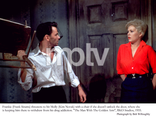 """""""The Man with the Golden Arm""""Frank Sinatra threatens to hit Kim Novak with a chair 1955 © 1978 Bob Willoughby - Image 3575_0032"""