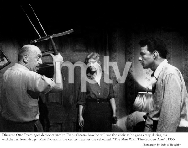 """The Man with the Golden Arm""""Director Otto Preminger demonstrates to Frank Sinatra how he will use the chair as he goes crazy during his withdrawal from drugs.  Kim Novak watches the rehearsal1955 © 1978 Bob Willoughby - Image 3575_0054"""