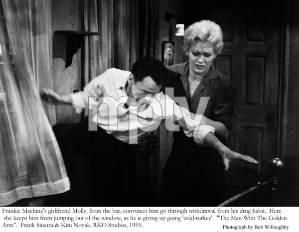 """The Man with the Golden Arm""Kim Novak keeps Frank Sinatra from jumping out of the window, as he is giving up drugs"