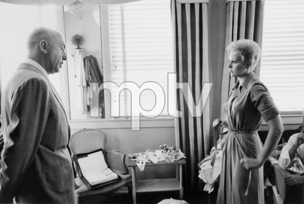 """""""The Man with the Golden Arm""""Director Otto Preminger looking at the wardrobe of Kim Novak1955 © 1978 Bob Willoughby - Image 3575_0075"""