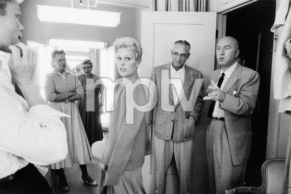 """""""The Man with the Golden Arm""""Costume designer Mary Ann Nyberg (far left), Kim Novak, production manager Jack McEdwards, director Otto Preminger1955 United Artists © 1978 Bob Willoughby - Image 3575_0104"""