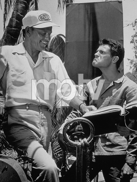 """""""None But The Brave""""Tommy Sands mugging his father in law Frank Sinatra on the set,1964. © 1978 David Sutton - Image 3619_0122"""