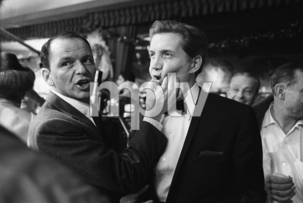 "Frank Sinatra jokes with his accompanist Bill Miller while working on the film ""Ocean"