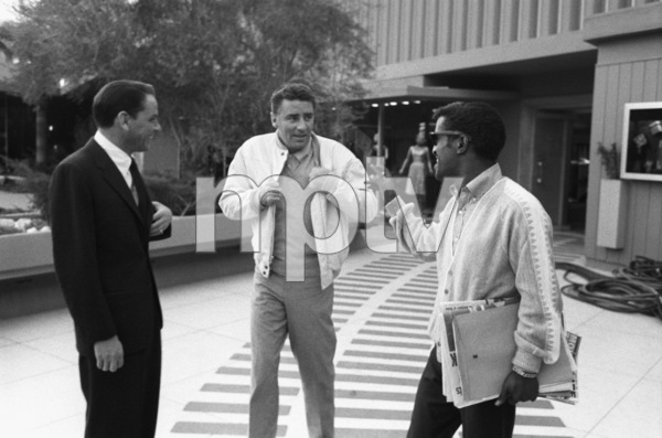 Frank Sinatra, Peter Lawford and Sammy Davis Jr. exchange banter en route to steam room at Sands Hotel in Las Vegas 1960 © 1978 Bob Willoughby - Image 3625_0091