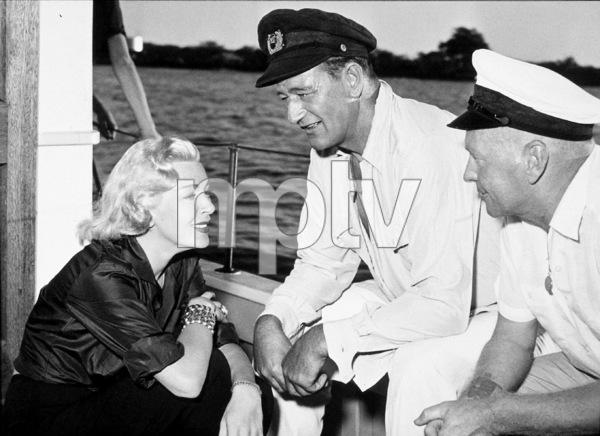 """The Sea Chase,"" Warner Bros. 1955.Lana Turner, John Wayne, and director, John Farrow, on location in Hawaii. - Image 3702_0006"
