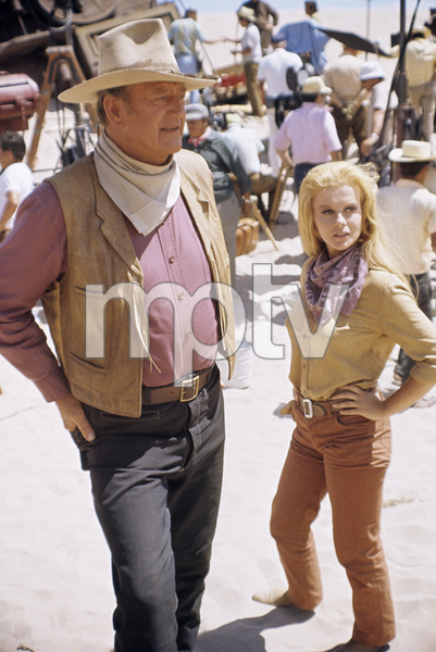 """John Wayne and Ann-Margret on the set of """"The Train Robbers""""1973 Warner Bros.© 1978 David Sutton - Image 3785_0155"""