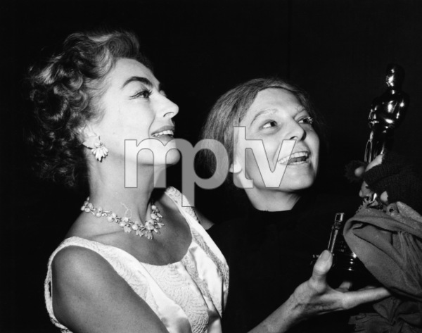 """Joan Crawford hands off Oscar to Anne Bancroft at """"The 35th Annual Academy Awards""""1963** I.V. - Image 3842_0235"""