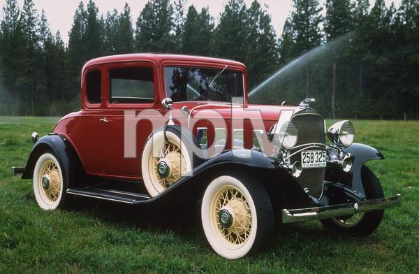 Car Category1932 Chevrolet Confederate BA Delux Sport CoupOwner John & Theresa Pence © 1994 Glenn EmbreeMPTV - Image 3846_0423