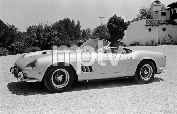 James Coburn driving his Ferrari 250 GT California at his Los Angeles home1966 © 1978 David Sutton - Image 3893_0039