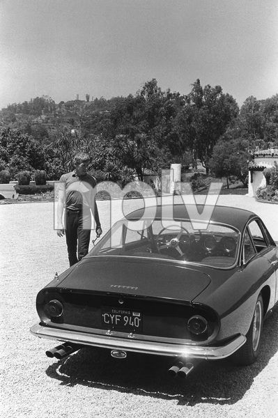 James Coburn with his Lusso Ferrari at his Los Angeles home1966 © 1978 David Sutton - Image 3893_0040