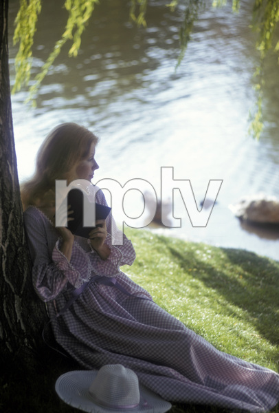 Fashion model reading by a lake1973 © 1978 Sid Avery - Image 3956_0955