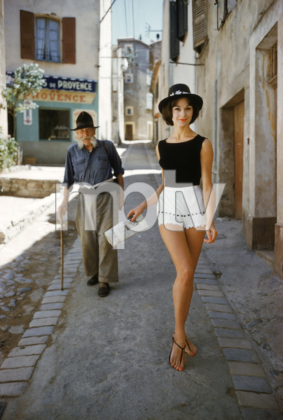 """St. Tropez model in shorts with admirer (photographed by Mark Shaw for the article """"The St. Tropez Way for the U.S.A."""" from the January 13, 1961 issue of Life, model """"Irene"""" is wearing shorts by Angelo)1961© 2011 Mark Shaw - Image 3956_1080"""