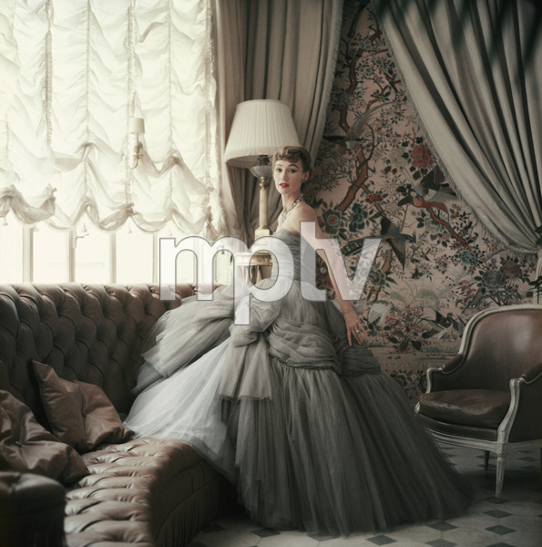 Dior fashion model Sophie Malgat wearing an evening dress from the Autumn-Winter Haute Couture collection, Vivante line) at the home of Christian Dior1953© 2013 Mark Shaw - Image 3956_1084
