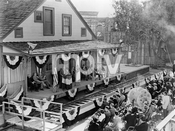 The dedication ceremony for The DeMille Barn (left to right: Cecil B. DeMille, Samuel Goldwyn, Jesse L. Lasky / At podium: Y. Frank Freeman / Far right, first row: John Anson Ford)1956** U.A.C. - Image 3972_0018