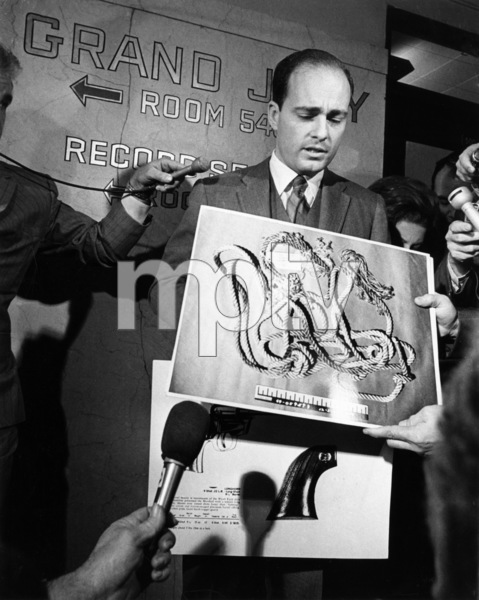 Los Angeles - Vincent Bugliosi displays a large photograph of the 43-foot nylon strand cord found draped around the necks of actress Sharon Tate and hair stylist Jay SebringDecember 1969  - Image 4203_0033