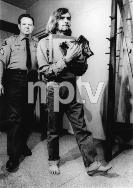 Charles Manson carrying notes and legal papers out of the courtroomFebruary 1970 - Image 4203_0049
