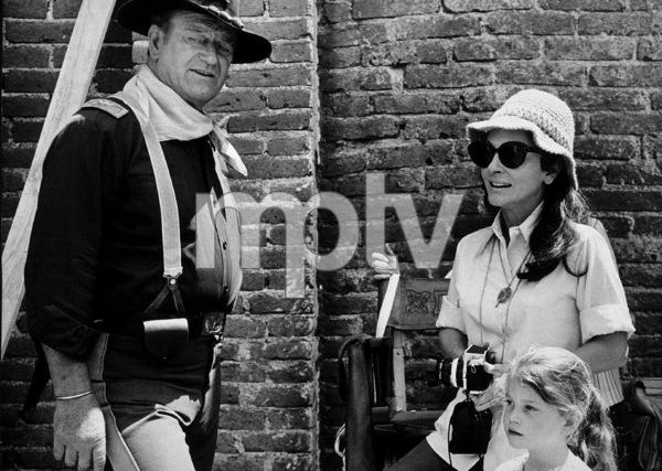 """Rio Lobo,"" Cinema Center 1970. John, Pilar, and Marisa Wayne during a break from filming. © 1978 David Sutton - Image 4229_0009"