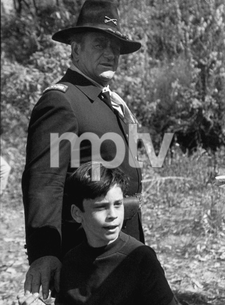 """Rio Lobo,"" Cinema Center 1970.John Wayne and his son, Ethan, during a break from filming. © 1978 David Sutton - Image 4229_0011"