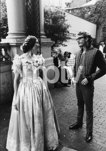 """Corin Redgrave chatting with his sister, Vanessa, as they wait to shoot a scene for the movie """"The Charge of the Light Brigade""""1968 - Image 4299_0001"""
