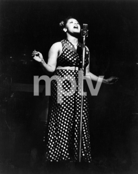 Billie Holiday performing at the Apollo Theater in New York City with The Count Basie Orchestra1937** I.V.M. - Image 4861_0020