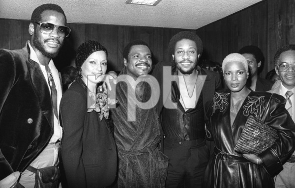 Billy Preston backstage at the Roxy in Hollywood with Tony Maiden of Rufus, Winnie Martin (Motown executive), Robert Wilson of the Gap Band and Fuller Gordy (Motown executive)1979© 1979 Bobby Holland - Image 4884_0011