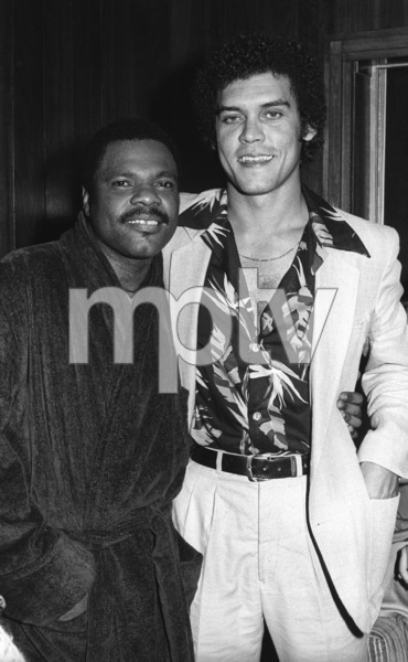 Billy Preston and Motown President Skip Miller backstage after a concert1980© 1980 Bobby Holland - Image 4884_0031
