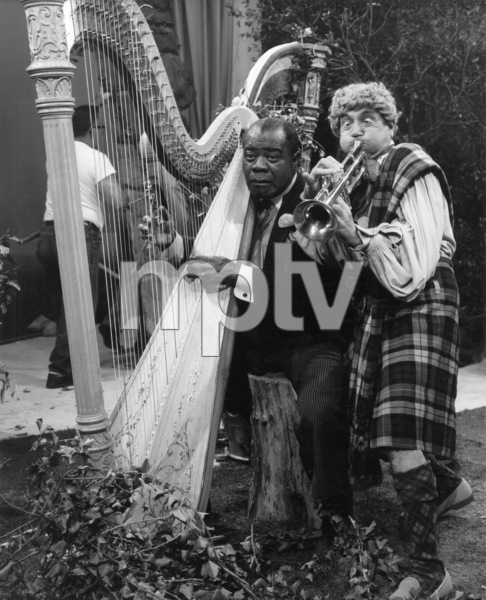 """Louis Armstrong and Harpo Marx in """"Swingin"""