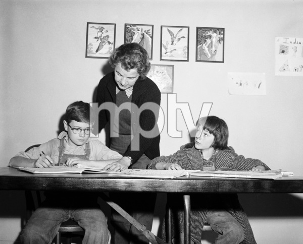 """Phillip Alford and Mary Badham on the set of """"To Kill a Mockingbird""""1962 Universal** B.D.M. - Image 5344_0032"""