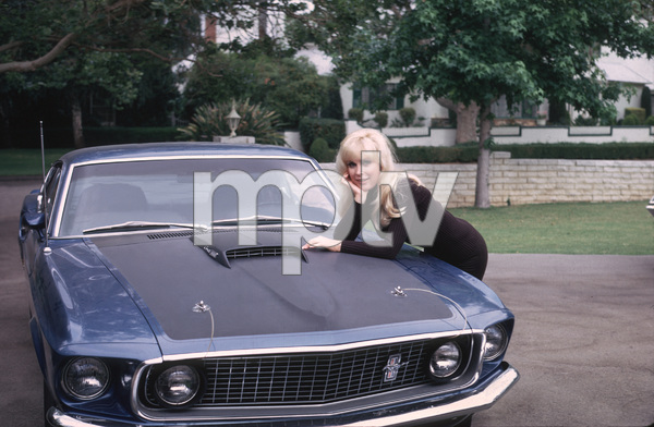 Barbara Edenand her 1969 428 Ford Mustangat Home in LA, CA 1970Photo by Herm Lewis / **H.L./ MPTV - Image 5357_0180