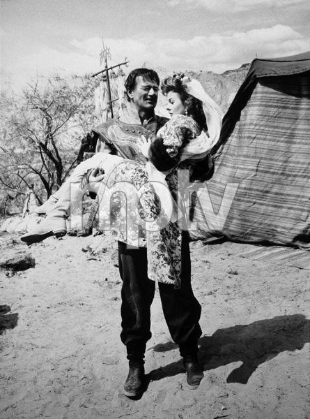 """The Conqueror,"" RKO 1955.John Wayne and Susan Hayward.Photo by Alexander Kahle. - Image 5761_0024"