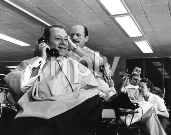 """George Raft and Lawrence Welk getting haircuts prior to the filming of the 1955 television show """"NBC Spectacular"""" © 1978 Sid Avery - Image 6054_0002"""
