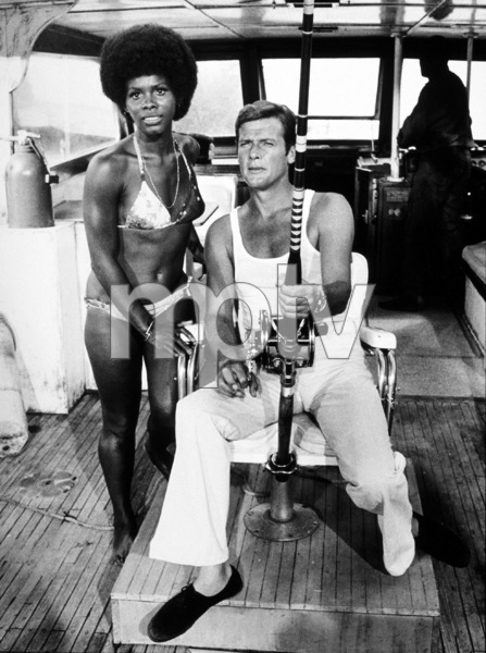 """""""Live and Let Die,"""" Gloria Hendry, Roger Moore © 1973 MGM / MPTV - Image 6773_0009"""
