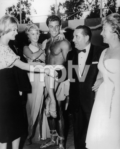 """Joseph E. Levine and his wife Rosalie (right) meet Hollywood starlet during his """"Afternoon with the Gods"""" party at Beverly Hills Hotel poolside11-15-1960 - Image 7148_0002"""