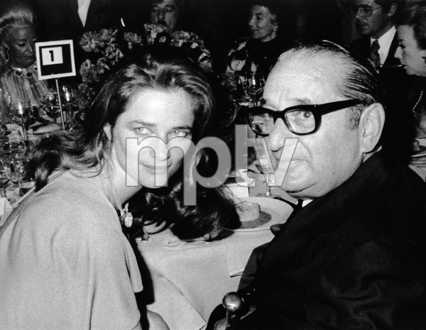 """Joseph E. Levine escorting Charlotte Rampling at a New York press party that marks the opening of """"The Night Porter"""" in New York10-03-1974 - Image 7148_0003"""