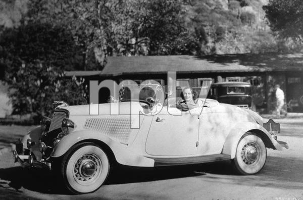 728-670 JOAN CRAWFORD IN HER 1934 FORD ROADSTERCIRCA 1934*M.W.*  - Image 728_670