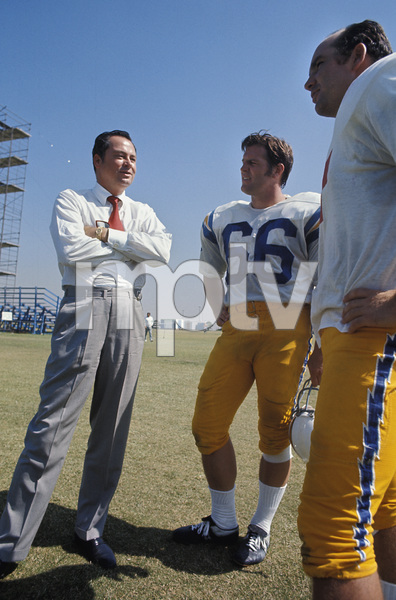 William Barron Hilton and two San Diego Chargers at Irvine Training Camp1970 © 1978 Gunther - Image 7485_0013