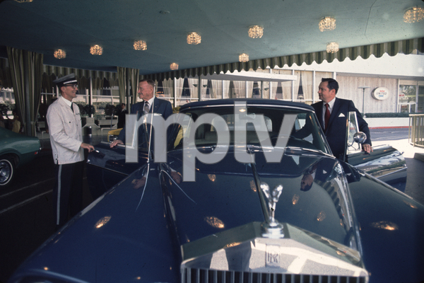 Conrad Hilton with his father Baron and theirRolls Royce C. 1978 © 1978 Gunther - Image 7485_1