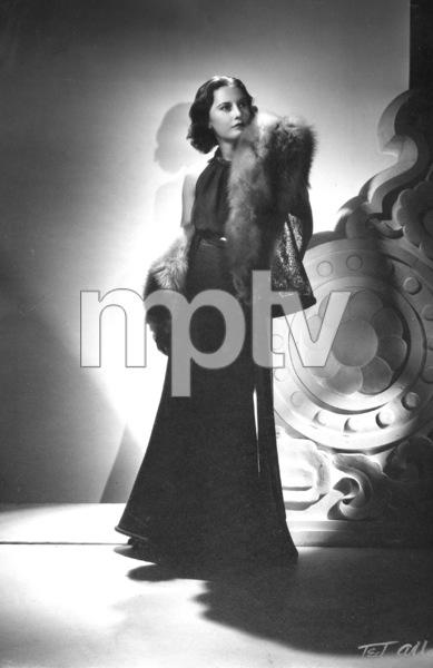 Barbara Stanwyck standing, circa 1936. © 1978 Ted AllanMPTV - Image 749_581