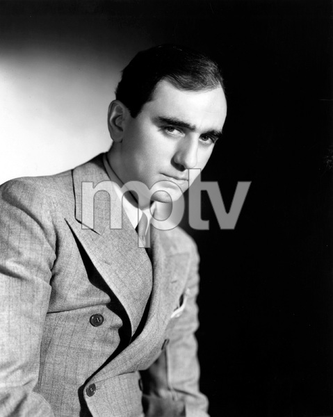Busby Berkeley, American film choreographer and director known for his lavish synchronized dance and production numbers, 1930