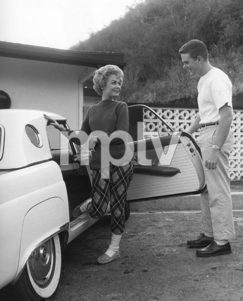 John Wilder opening the door of a 1956 Ford Thunderbird for Sandra Deecirca 1956Photo by Joe Shere - Image 7678_0109