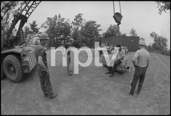 Construction workers joke with Muhammad Ali1974© 1978 Peter Angelo Simon - Image 7683_0504