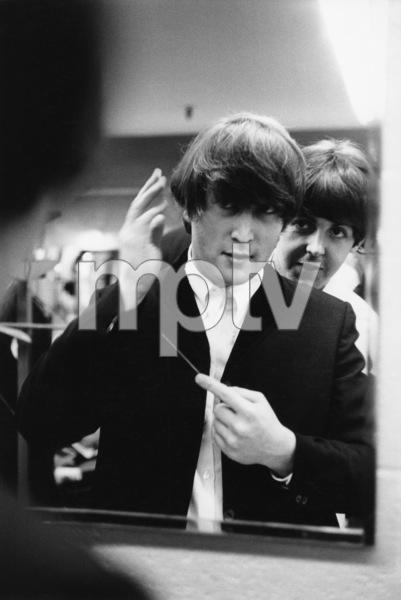 The BeatlesJohn Lennon and Paul McCartney backstage fixing John