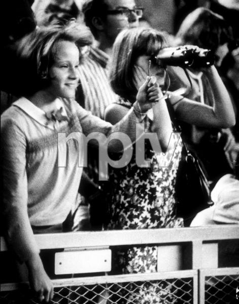 Beatles fans enjoying the concert. The girl on the right looks through a binocularAugust 17, 1965 - Image 7685_0158