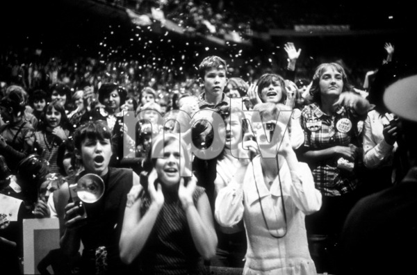 Beatles Fans enjoying the concertBeatles USA Tour. Confetti being thrown around1964 © 1978 Gunther /  MPTV - Image 7685_0162