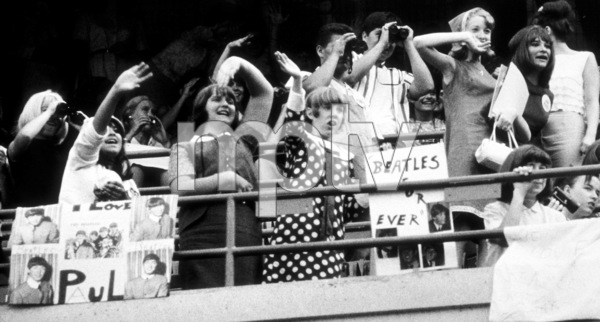 Beatles Fans enjoying the concert at Shea Stadium, Aug. 15, 1965 © 1978 George E. Joseph - Image 7685_0167